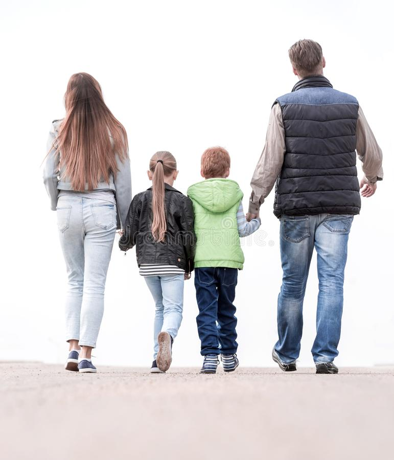 Rear view.happy family walking together. royalty free stock image