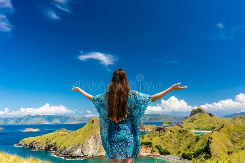 Happy tourist enjoying the breeze during summer vacation in Padar Island royalty free stock photo