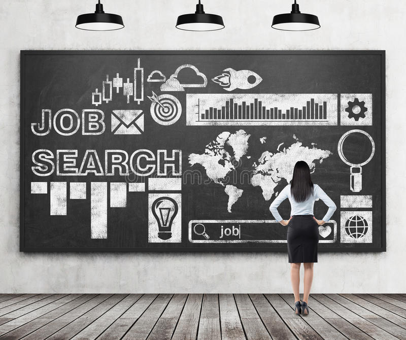 Rear view of a lady in formal clothes who is looking at the huge black chalk board with drawn icons about job search proc stock images