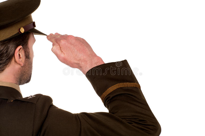 Rear view of male army soldier saluting stock image