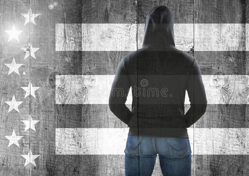 Rear view of man against Black and white american flag stock images