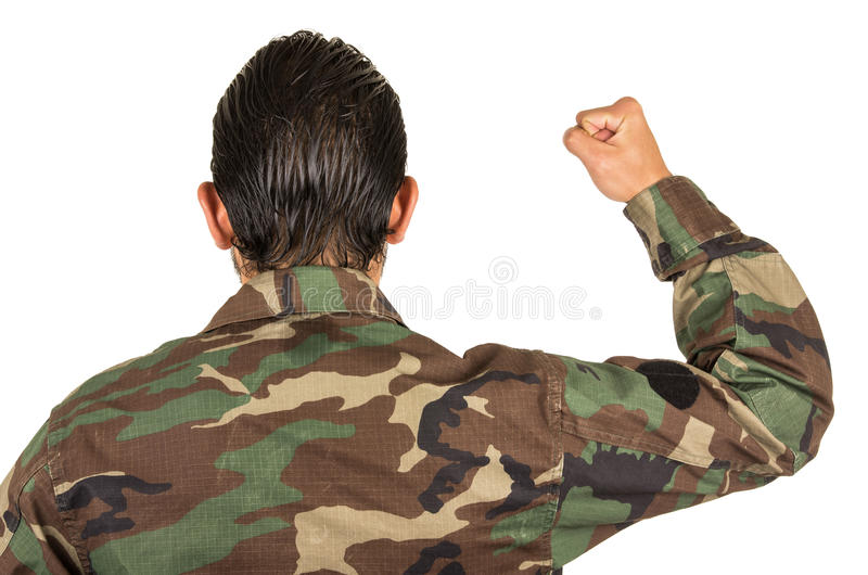 Rear view of man in military uniform with fist up royalty free stock image