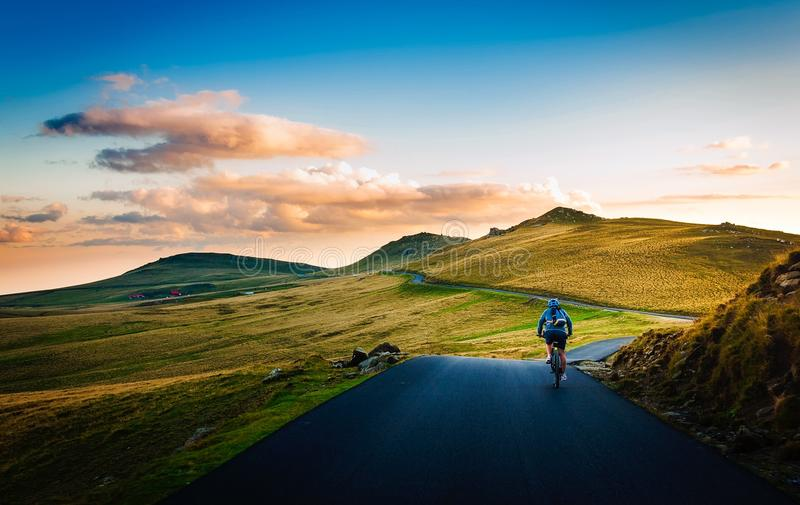 Rear View of Man on Mountain Road Against Sky royalty free stock photography