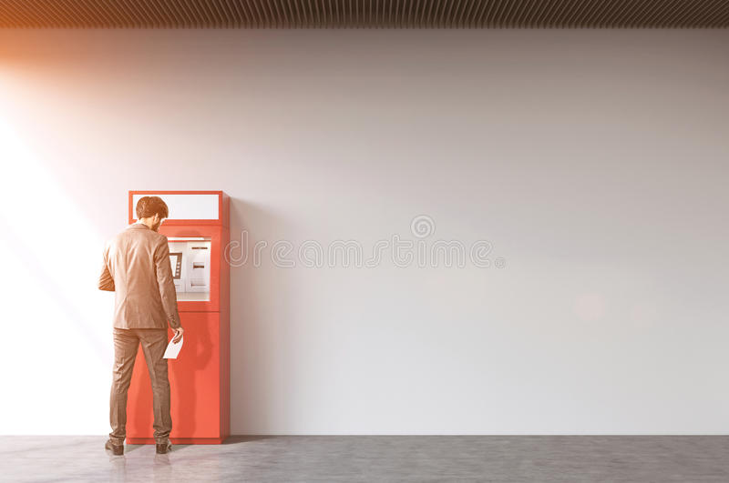 Download Rear View Of Man Near A Red ATM Machine Stock Image - Image: 83722069