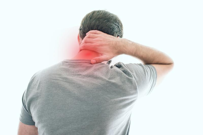 Rear view of man with neck pain. Rear view of man suffering from neck pain royalty free stock images