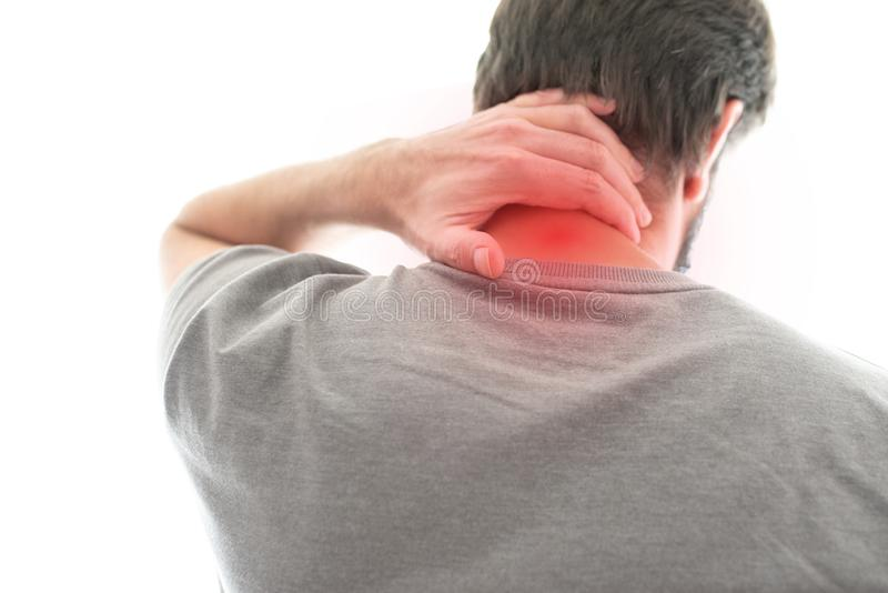 Rear view of man with neck pain. Rear view of man suffering from neck pain stock photo