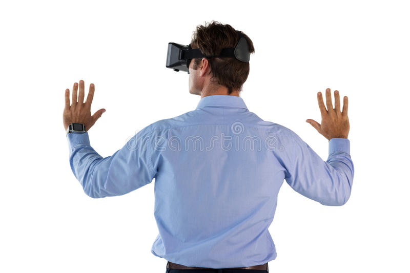 Rear view of man wearing VR glasses. Against white background stock photos