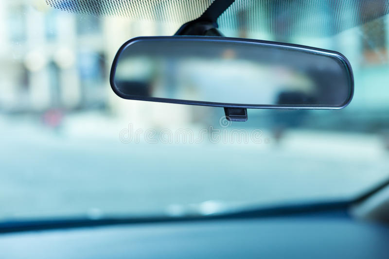 Rear-view mirror adjusted to the windshield royalty free stock photo