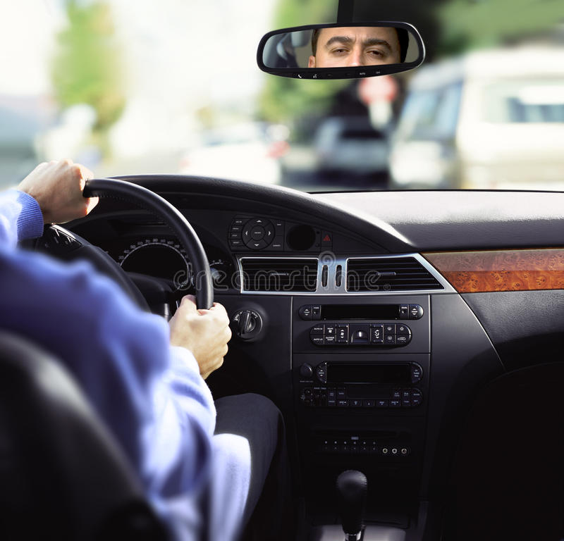 Rear-view mirror and dashboard stock photo