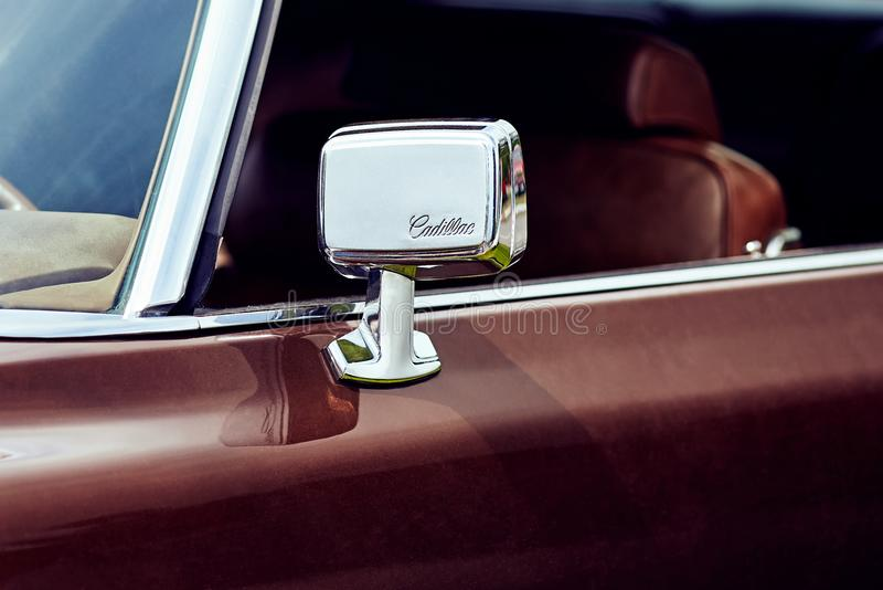 Rear-view mirror of a full-size personal luxury car Cadillac Eldorado. Rostov-on-Don, Russia - May 6, 2018: Rear-view mirror of a full-size personal luxury car royalty free stock photo