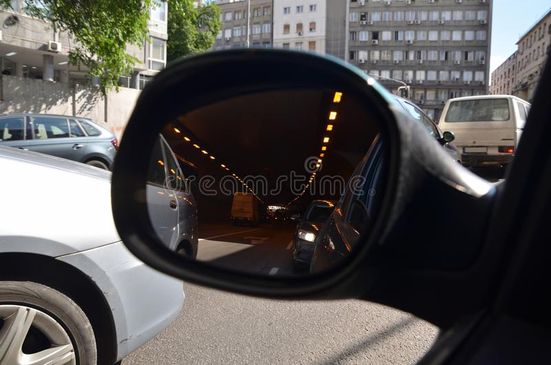 City traffic in a rear view mirror royalty free stock photography