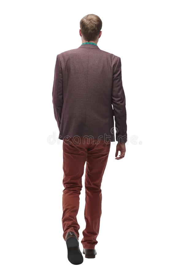 Rear view. a modern young man goes forward. stock photos