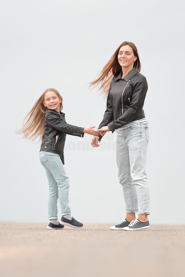 Rear view. mother and daughter holding each other`s hands royalty free stock photography