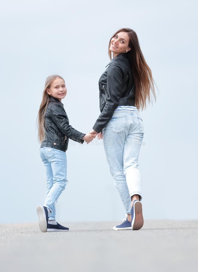 Rear view. mother and daughter step forward stock images