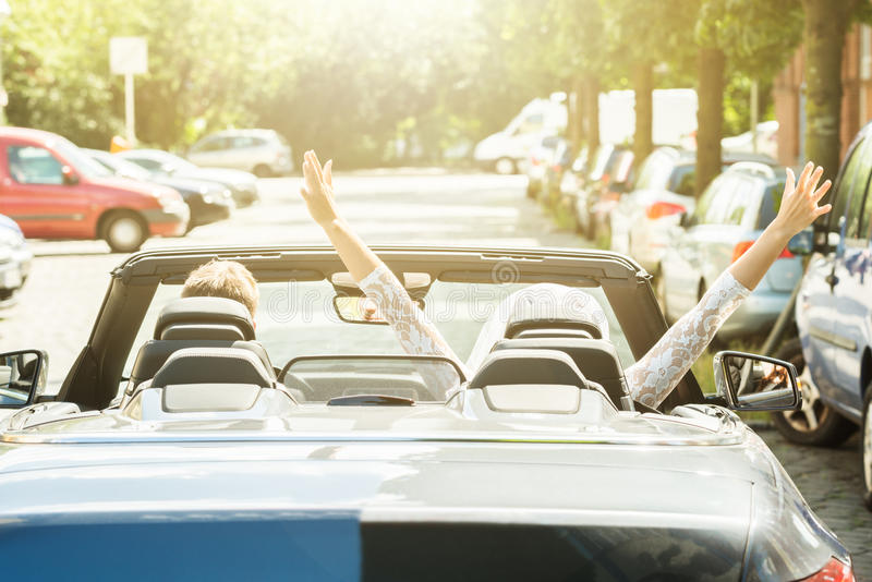 Newlyweds Couple Traveling In The Car stock image