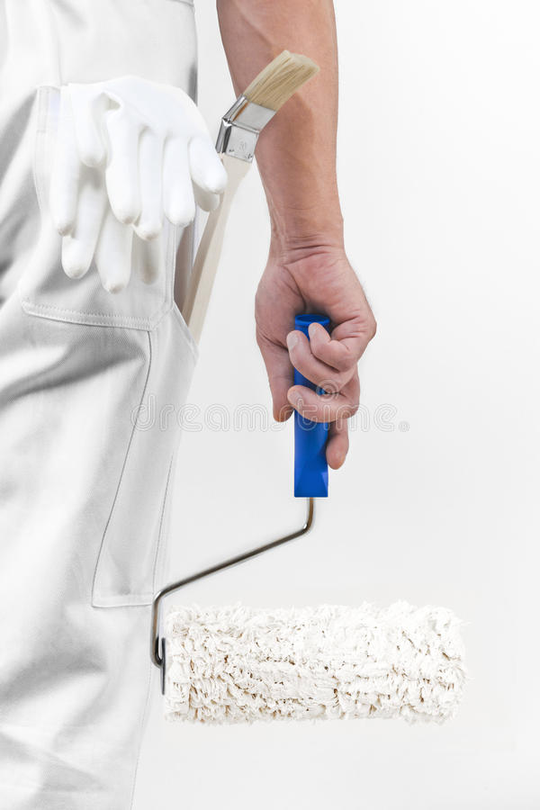 Rear view of painter man with paint roller. stock image