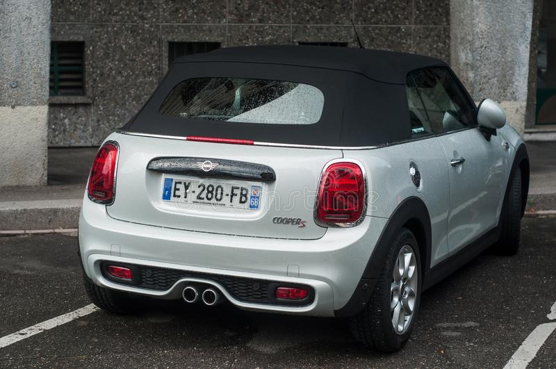 Rear view of pearly Mini cooper convertible car parked in the street. Mulhouse - France - 8 September 2019 - Rear view of pearly Mini cooper convertible car stock photography