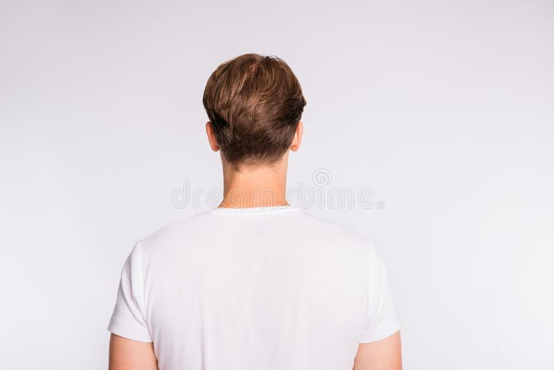 Rear view photo of amazing hair styling guy wear casual outfit  on white background stock photo