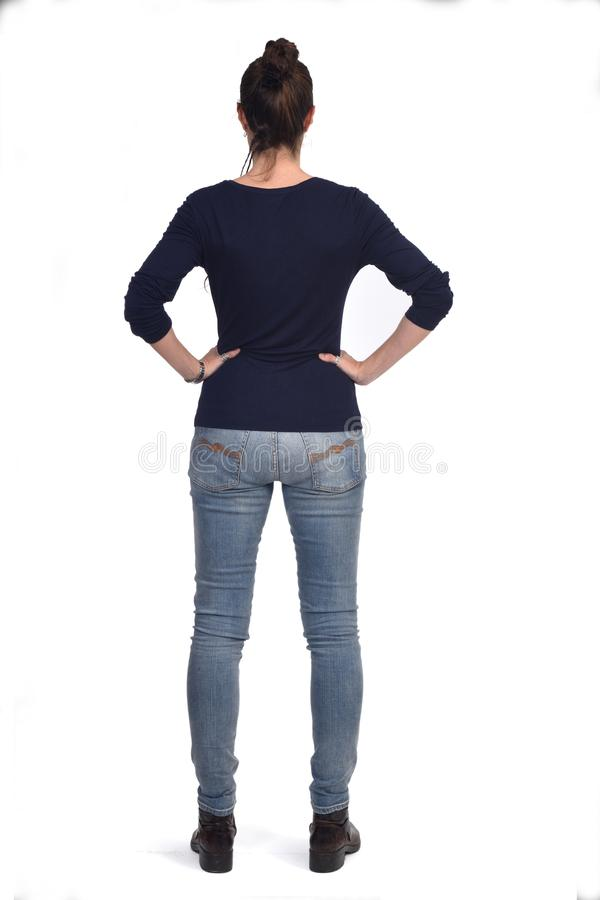 Rear view portrait of a woman hands on the hips stock photography