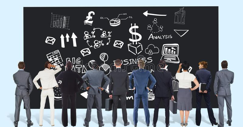 Rear view of professionals looking at business graphics on black board stock photos