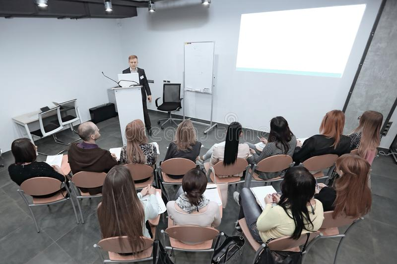 Rear view.the project Manager conducts a meeting royalty free stock image