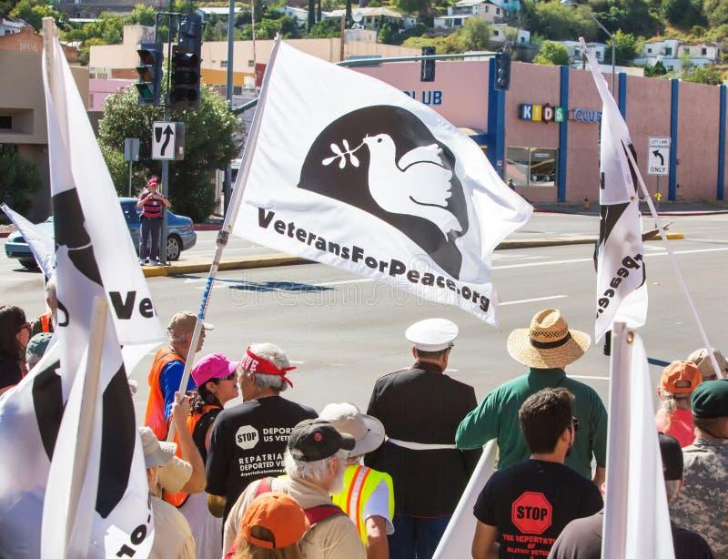 Rear view of protestors marching toward border. NOGALES, AZ - OCTOBER 08: Rear view of protestors marching toward the US and Mexico borders on October 08, 2016 stock images