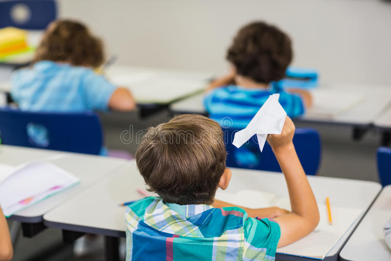 Rear view of pupil a paper plane royalty free stock photos