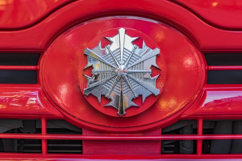 Rear view of a red Japanese fire truck with its silver head mark star in front.  stock photos