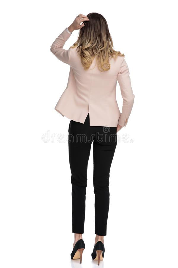 Rear view of relaxed businesswoman thinking royalty free stock photography