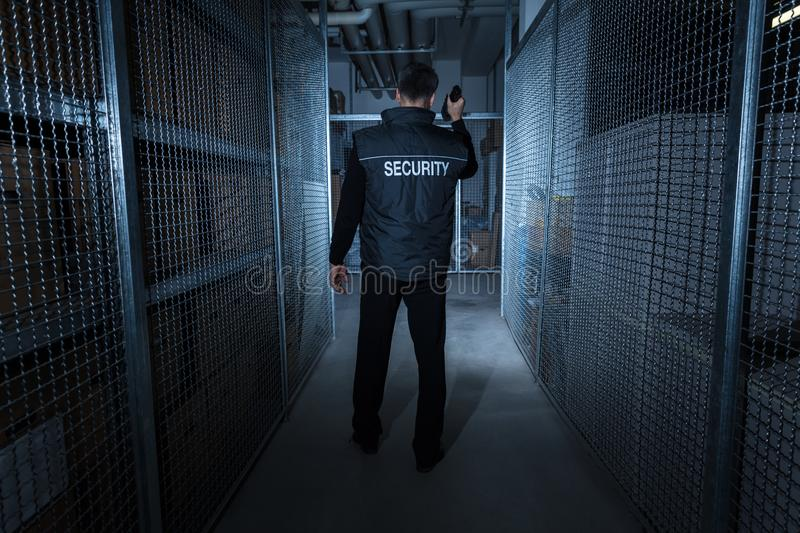 Security Guard Standing In The Warehouse stock images