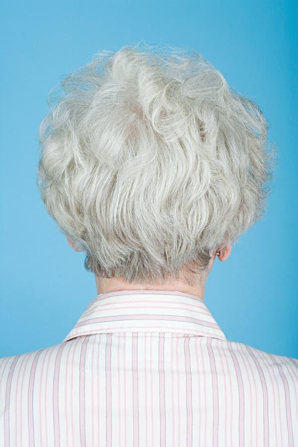 Rear view of senior woman stock photos