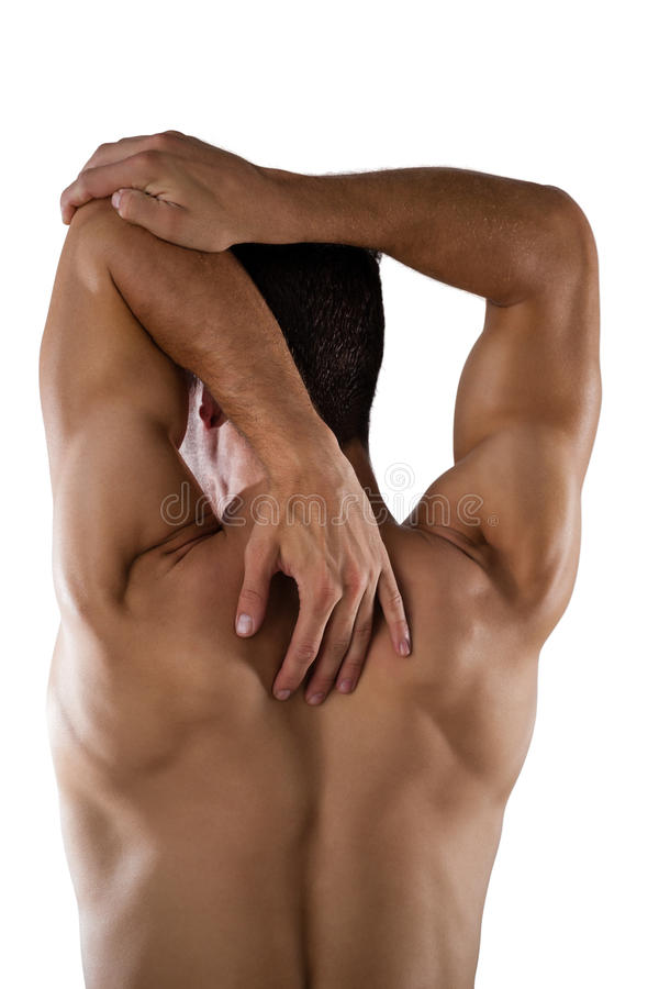 Rear view of shirtless sports person stretching hands. While standing against white background stock photos