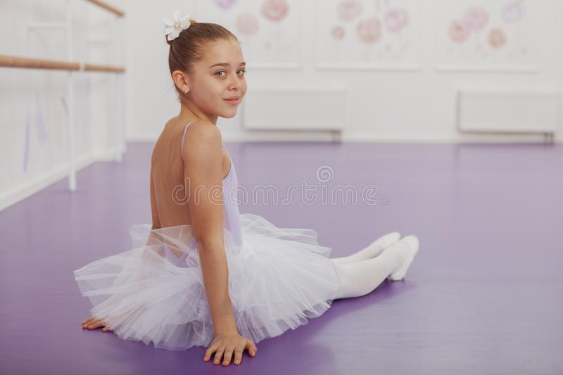 Gorgeous young girl ballerina practicing at dance studio royalty free stock photography