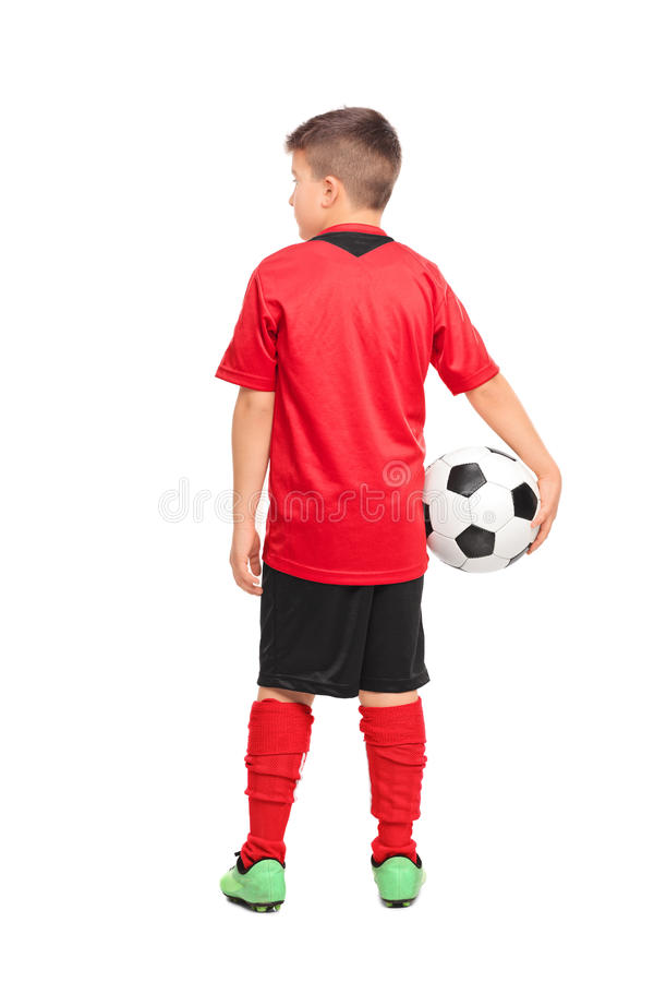 Rear view shot of a junior soccer player holding a ball. Full length portrait of a junior soccer player holding a ball isolated on white background, rear view stock images
