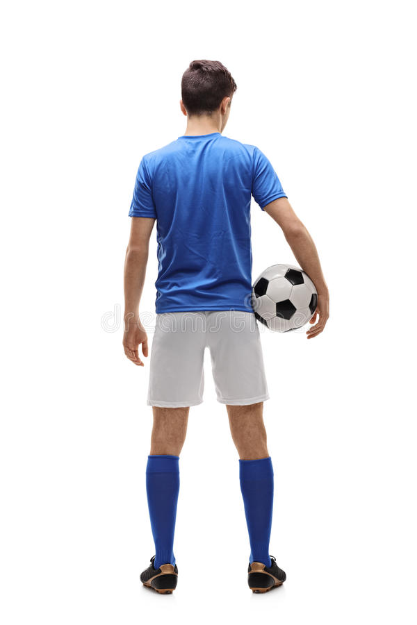 Rear view shot of a teenage football player. Full length rear view shot of a teenage football player isolated on white background stock photography
