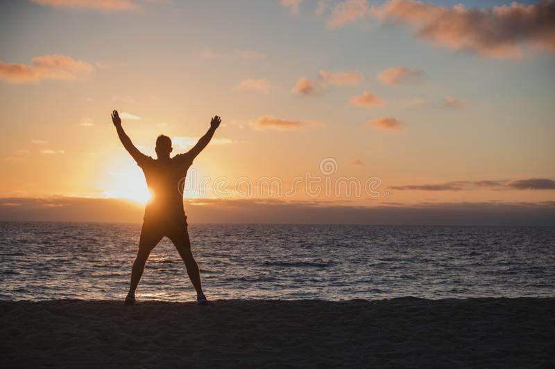 Jumping Jacks on the Beach stock photo