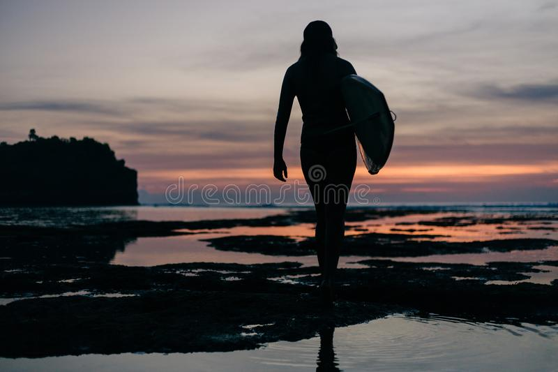 rear view of silhouette of woman royalty free stock photo