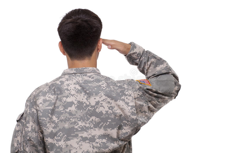 Rear view of a soldier saluting stock images
