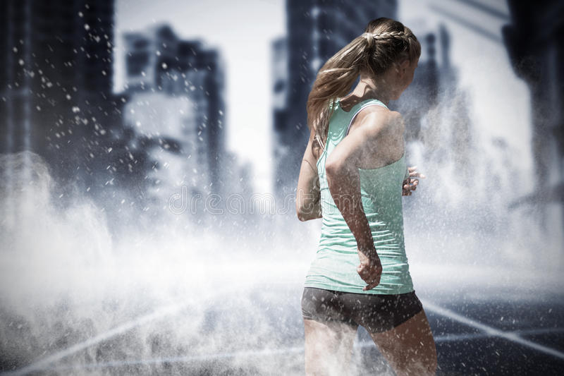 Composite image of rear view of sportswoman running on a white background stock image