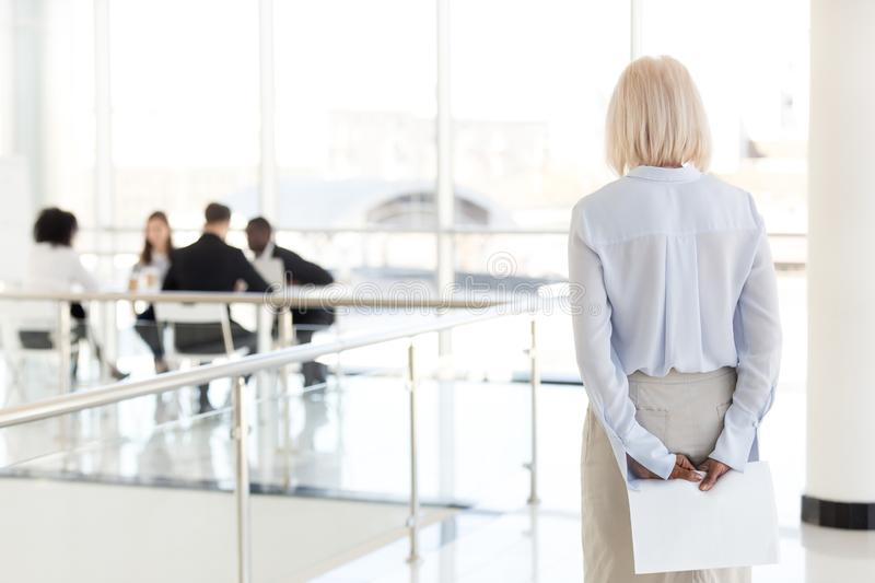 Rear view at stressed nervous senior businesswoman waiting for i stock images