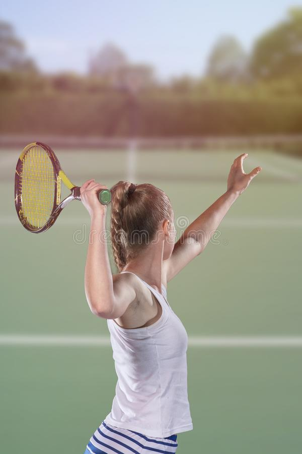 Rear view of tennis player serving during a match stock photos