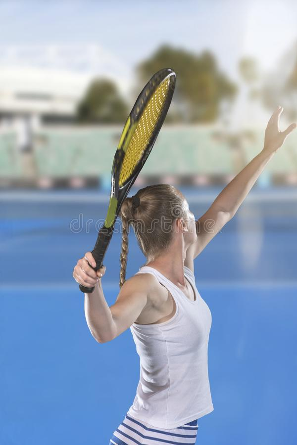 Rear view of tennis player serving during a match royalty free stock photos