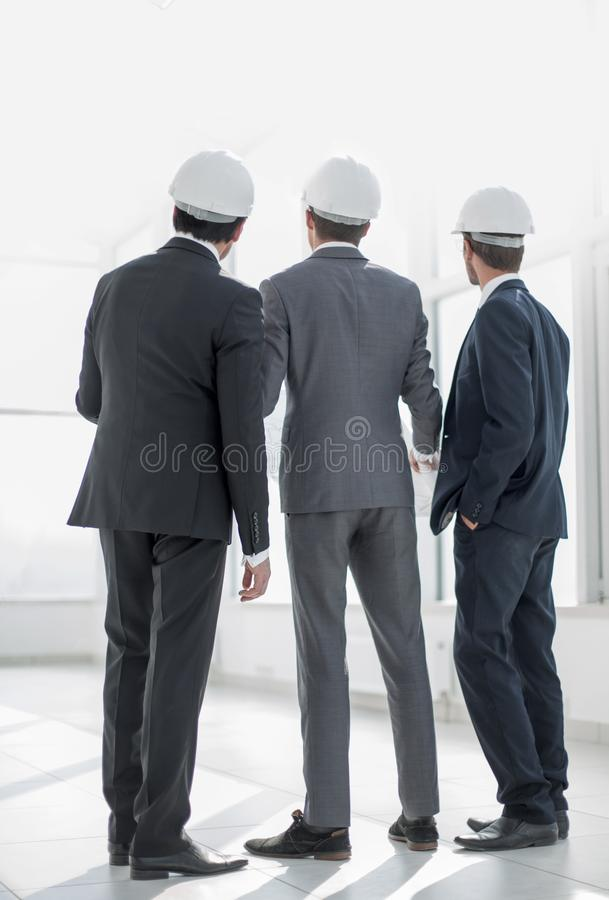 Rear view.three architects looking at the copy space royalty free stock photography