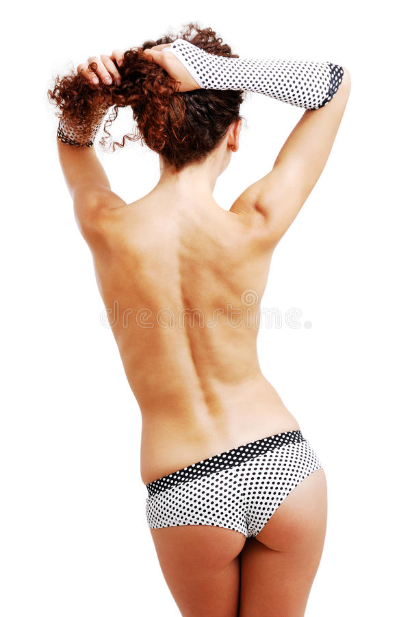 Download Rear View Of Topless Girl In Shorts And Gloves. Stock Image - Image: 20640821