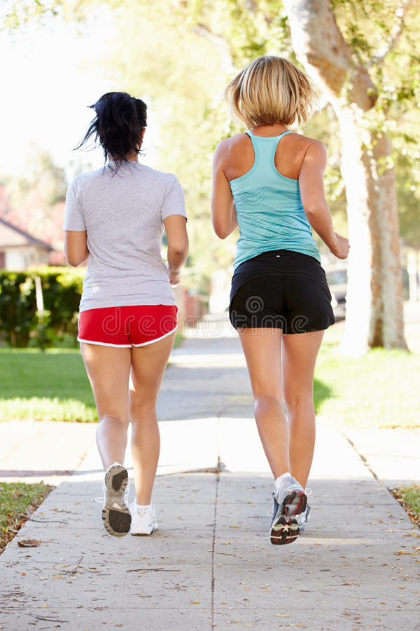 Download Rear View Of Two Female Runners On Suburban Street Stock Image - Image: 31347761