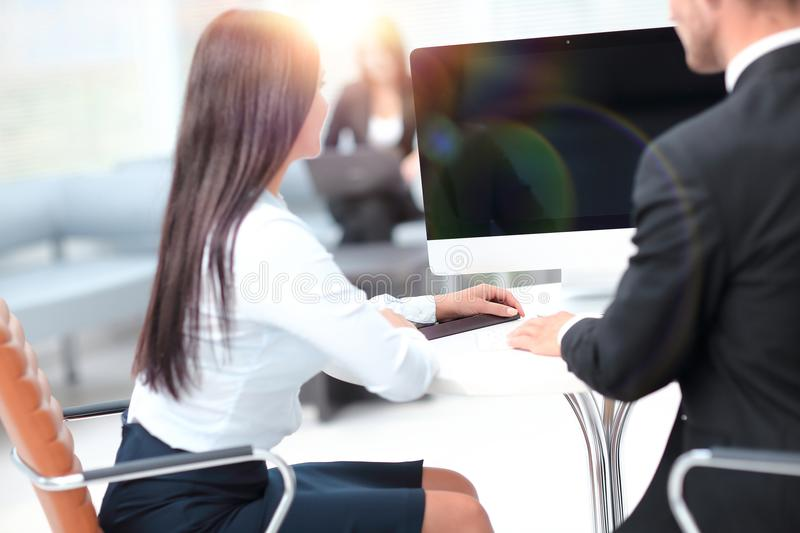 Rear view.two successful employee sitting behind a Desk. Photo with copy space stock photo