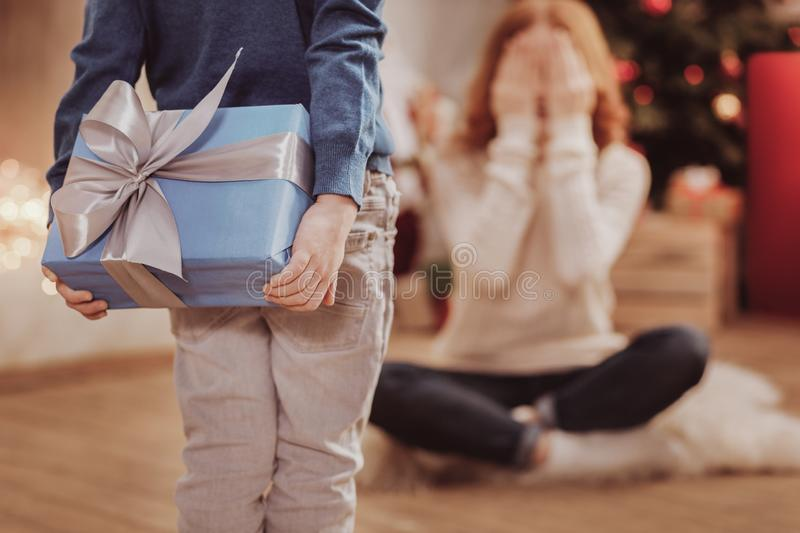 Rear view of unpredictable present for mother stock images