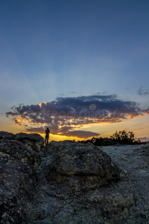 Rear view of unrecognizable male photographer taking pictures of the sunset over the Stone Mushrooms near Beli Plast village, royalty free stock photos