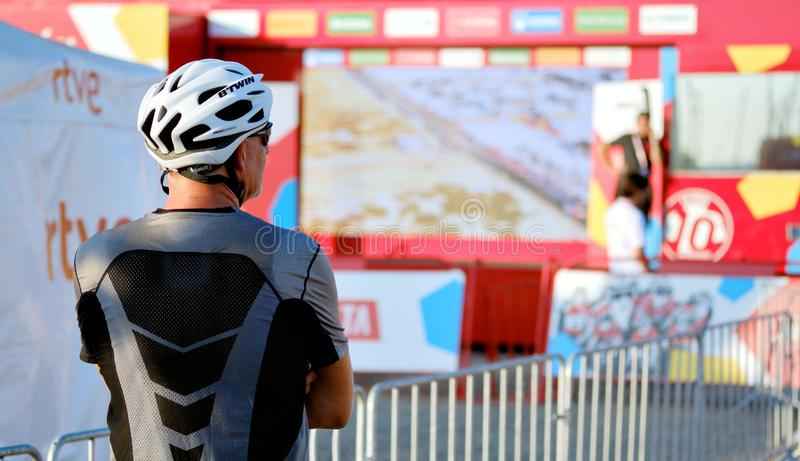 Rear view unrecognizable sportsman or just spectator during popular competition La Vuelta. Torrevieja, Spain - August 24, 2019: Rear view unrecognizable stock photography