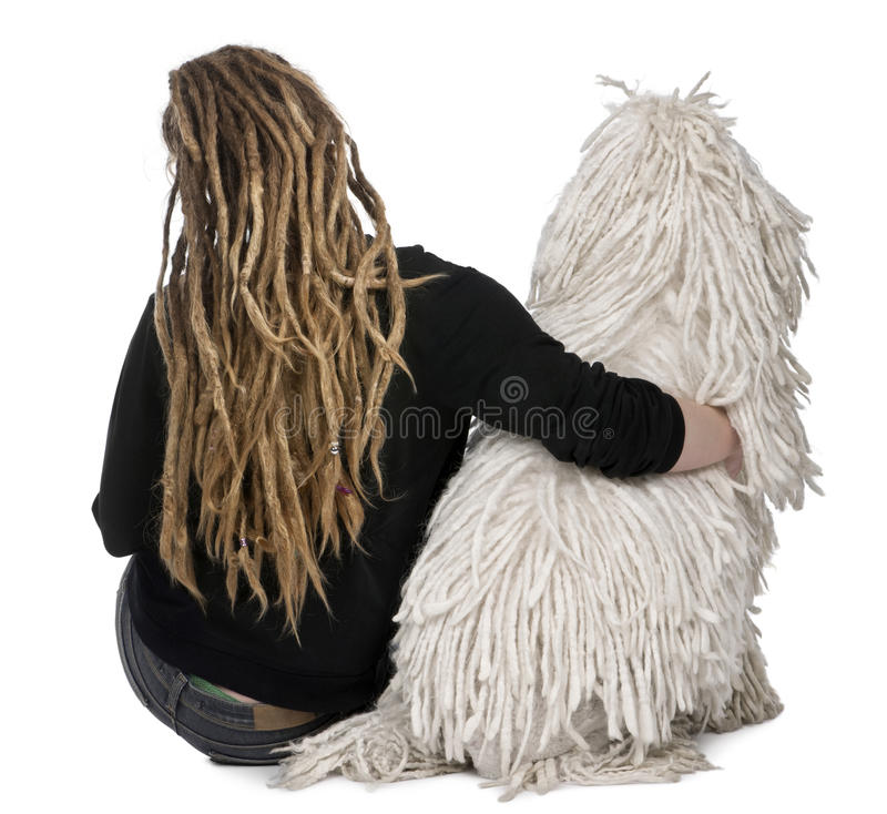 Rear view of a White Corded Poodle and a girl stock photography